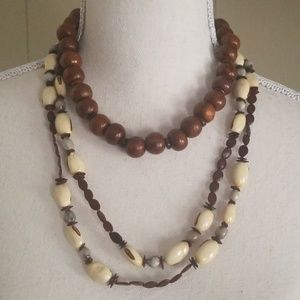 Two necklaces - beads and shells.